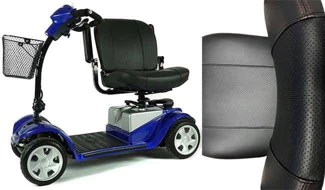 Le siège confort noir et les accoudoirs pliables du scooter électrique médical Kymco Mini LS